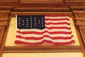 A U.S. Flag with 33 stars.